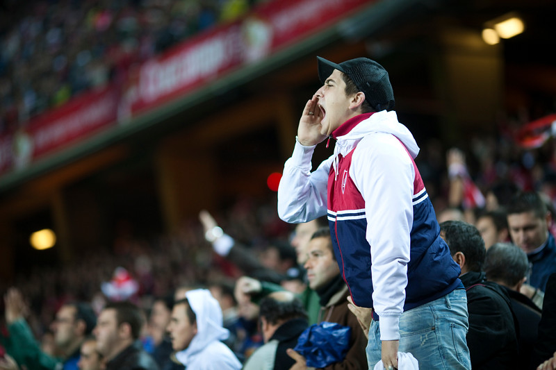 Sevilla FC fan shouting. Spanish Cup game between Sevilla FC and FC Barcelona, Ramon Sanchez Pizjuan stadium, Seville, Spain, 13 January 2010