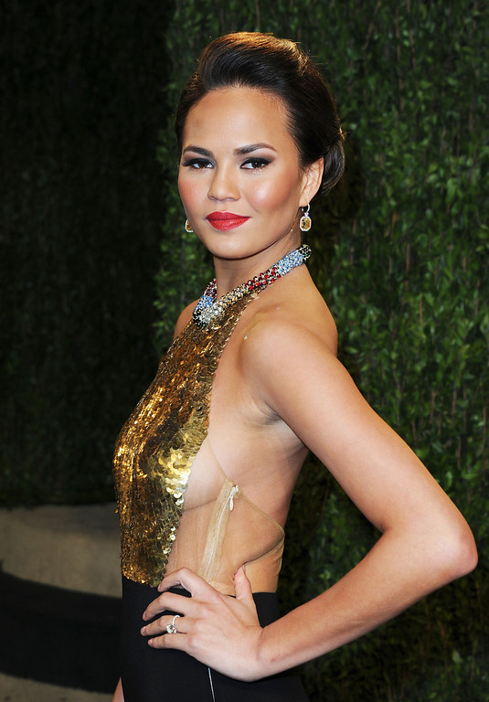 . Model Chrissy Teigen arrives at the 2013 Vanity Fair Oscar Party hosted by Graydon Carter at Sunset Tower on February 24, 2013 in West Hollywood, California.  (Photo by Pascal Le Segretain/Getty Images)
