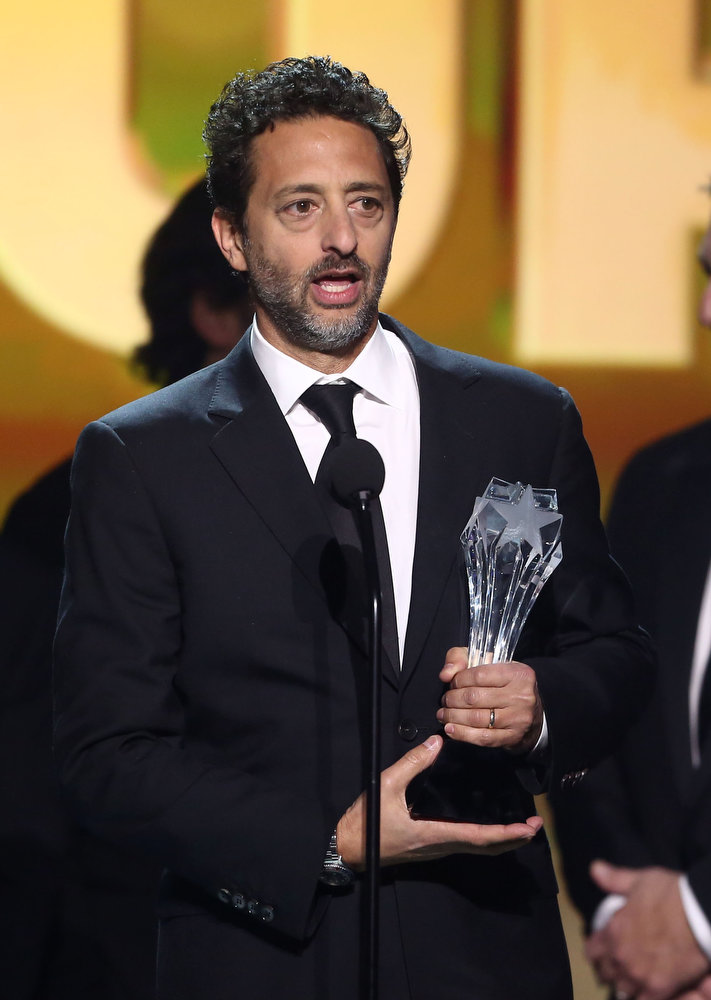 """. Grant Heslov accepts the award for best picture for \""""Argo\"""" at the 18th Annual Critics\' Choice Movie Awards at the Barker Hangar on Thursday, Jan. 10, 2013, in Santa Monica, Calif.  (Photo by Matt Sayles/Invision/AP)"""