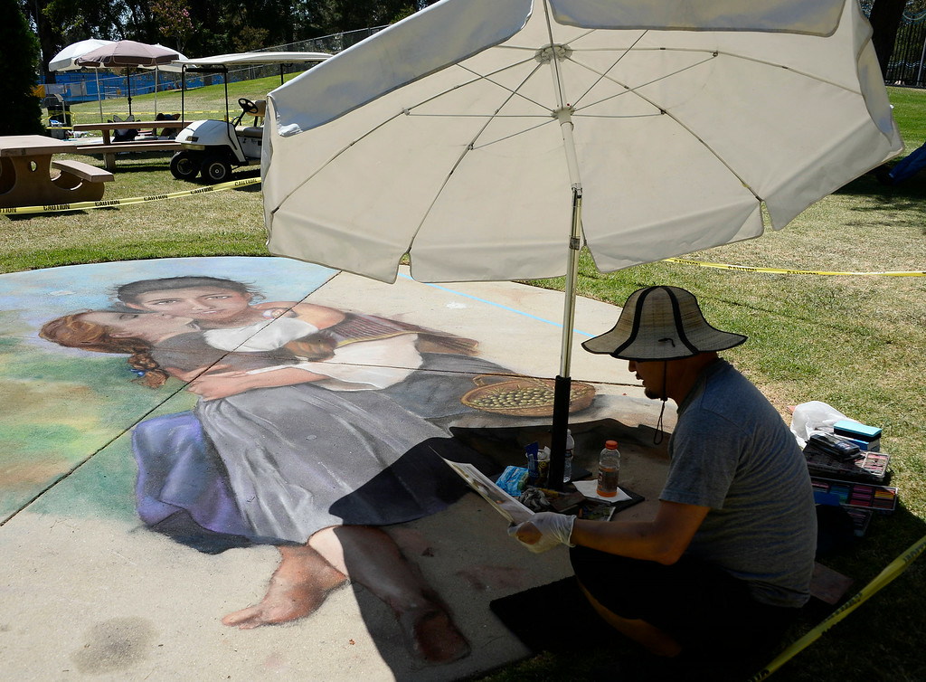 . Aug 31,2014, sylmar CA. Chalk Artist Willie Zin works on his art pice during the 2014 Sylmar Olive Festival.  Photo by Gene Blevins/LA DailyNews