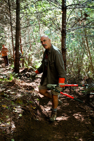 Joe Barcott, NWTA board member 2010 - limbing along new trail at Stub
