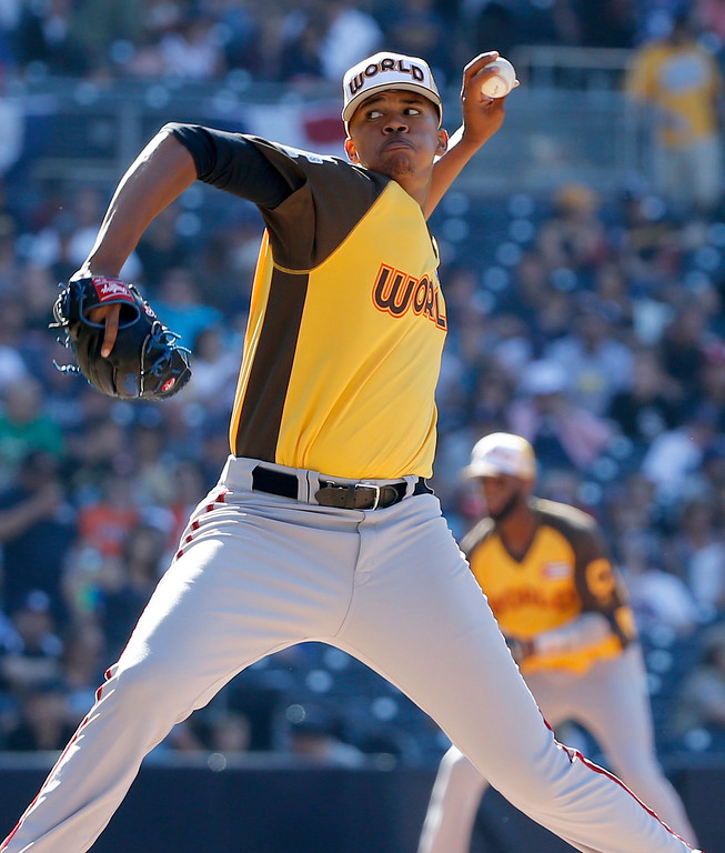. World Team pitcher Angel Perdomo, of the Toronto Blue Jays, throws against the U.S. Team during the third inning of the All-Star Futures baseball game, Sunday, July 10, 2016, in San Diego. (AP Photo/Lenny Ignelzi)