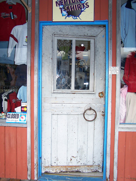 Door at Neptune Shirts, Fisherman's Wharf in Monterey, CA.