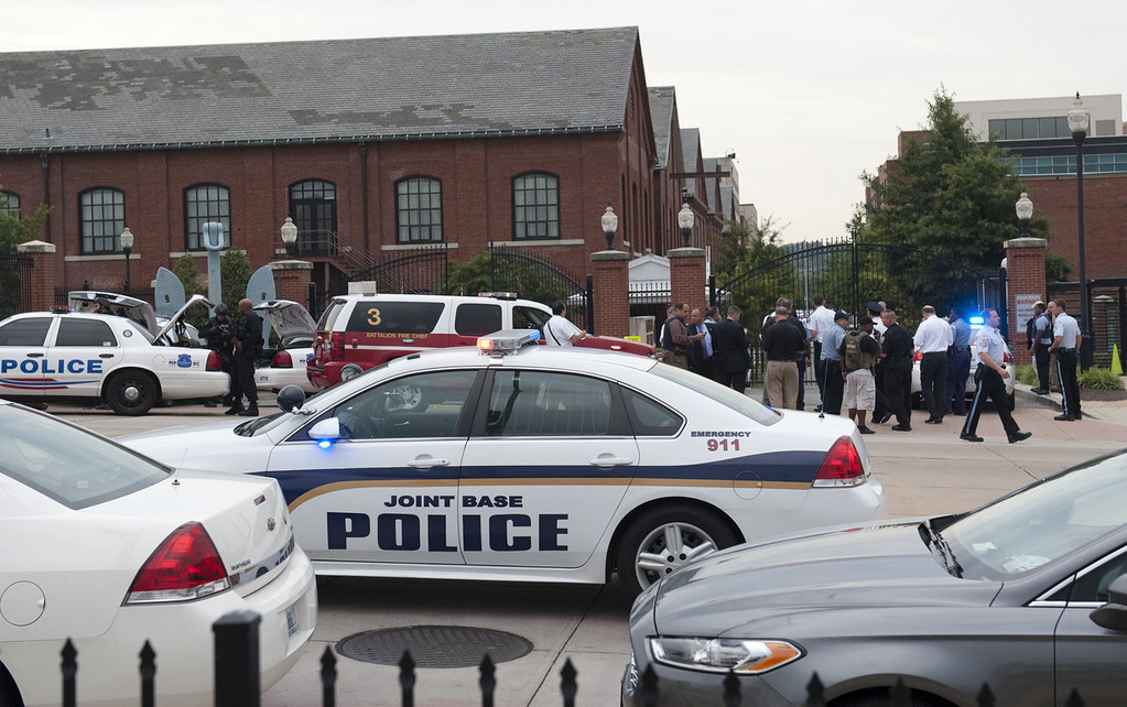 ". Police respond to the report of a shooting at the Navy Yard in Washington, DC, September 16, 2013.  A gunman shot and wounded at least one person Monday in a headquarters building at the US Navy Yard in Washington and is still at large, the navy said.""There is one confirmed injury. Emergency personnel are on scene and a \'shelter in place\' order has been issued for Navy Yard personnel,\"" the navy said in a statement. Local television reported that there were as many as five casualties and the Navy said that police had entered building number 197 in search of the shooter. The Navy said at least three shots were fired at 8:20 am (1320 GMT) in the headquarters building of the Naval Sea Systems Command.   SAUL LOEB/AFP/Getty Images"