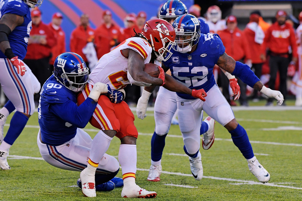 . New York Giants defensive end Jason Pierre-Paul, left, tackles Kansas City Chiefs\' Kareem Hunt (27) during the second half of an NFL football game Sunday, Nov. 19, 2017, in East Rutherford, N.J. (AP Photo/Bill Kostroun)