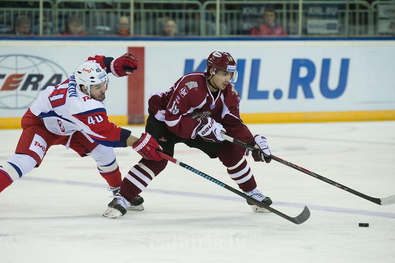 Daniil Apalkov (40) of Lokomotiv Yaroslavl tries to stop Mikelis Redlihs (19)