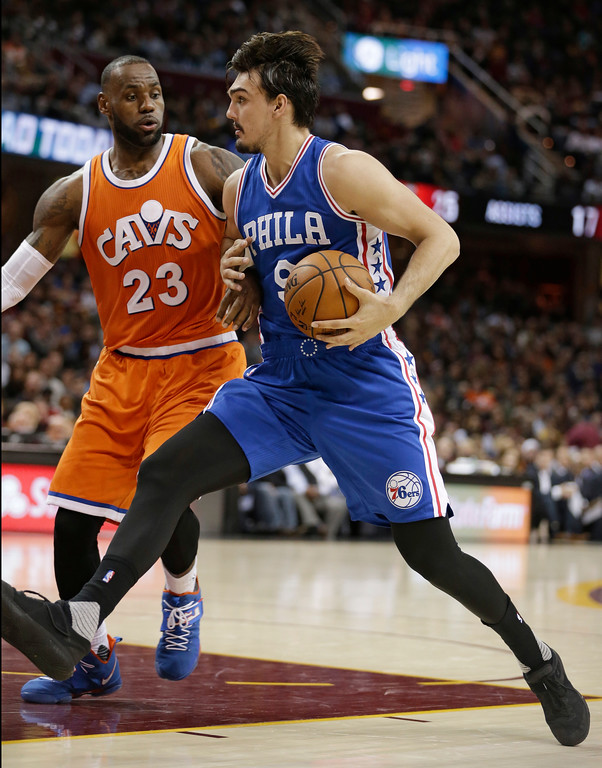 . Philadelphia 76ers\' Dario Saric (9), from Croatia, drives against Cleveland Cavaliers\' LeBron James (23) in the second half of an NBA basketball game, Friday, March 31, 2017, in Cleveland. The Cavaliers won 122-105. (AP Photo/Tony Dejak)