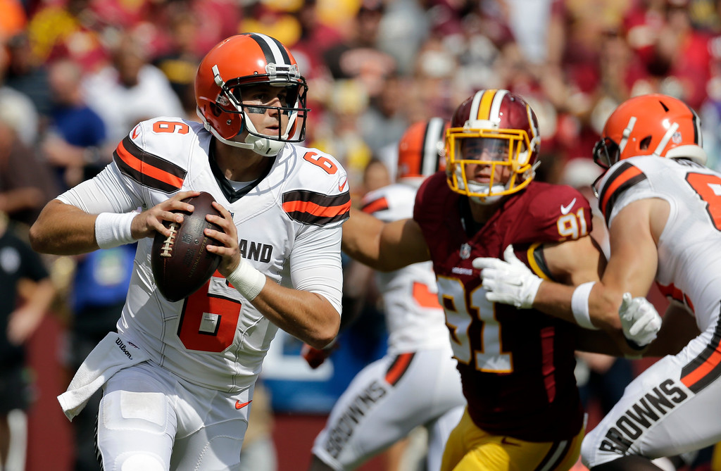 . Cleveland Browns quarterback Cody Kessler (6) looks to pass under pressure from Washington Redskins outside linebacker Ryan Kerrigan (91) during the first half of an NFL football game Sunday, Oct. 2, 2016, in Landover, Md. (AP Photo/Chuck Burton)