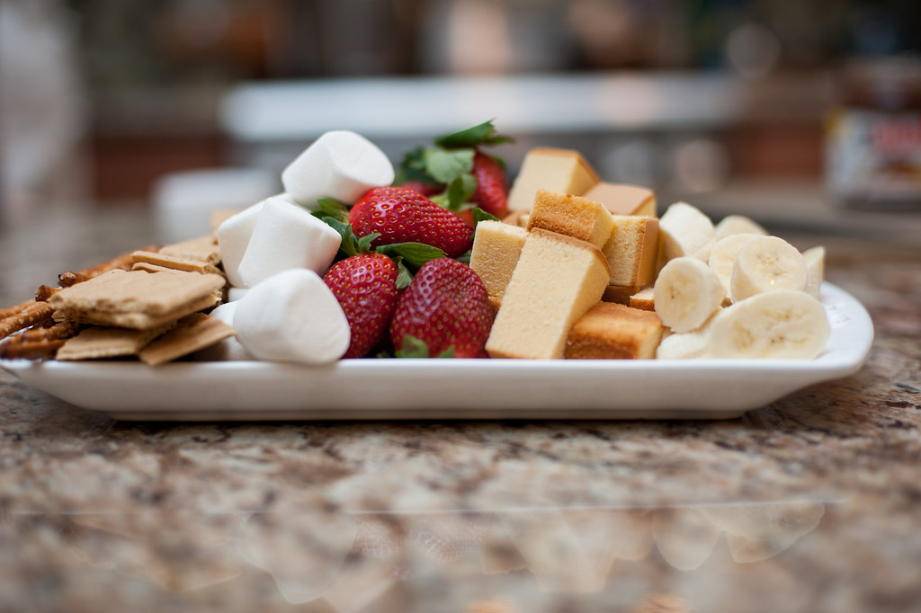 . Graham crackers, marshmallows, strawberries, pound cake, pretzels and bananas are shown as ideas for dipping in fondue. (Sun photo by Holly Mahaffey/@hollymahaffey)