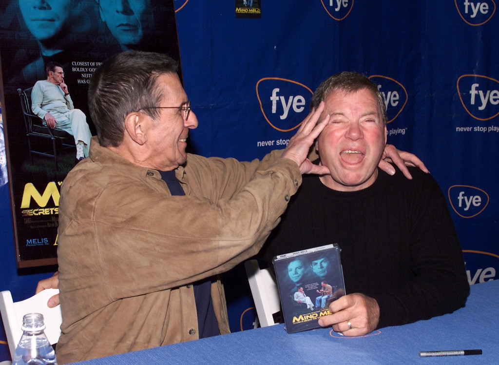 """. Leonard Nimoy and William Shatner at a DVD/video signing for \""""Mind Meld: Secrets Behind the Voyage of a Lifetime\"""" at FYE in Los Angeles, Ca. Sunday, March 17, 2002. Photo by Kevin Winter/ImageDirect."""