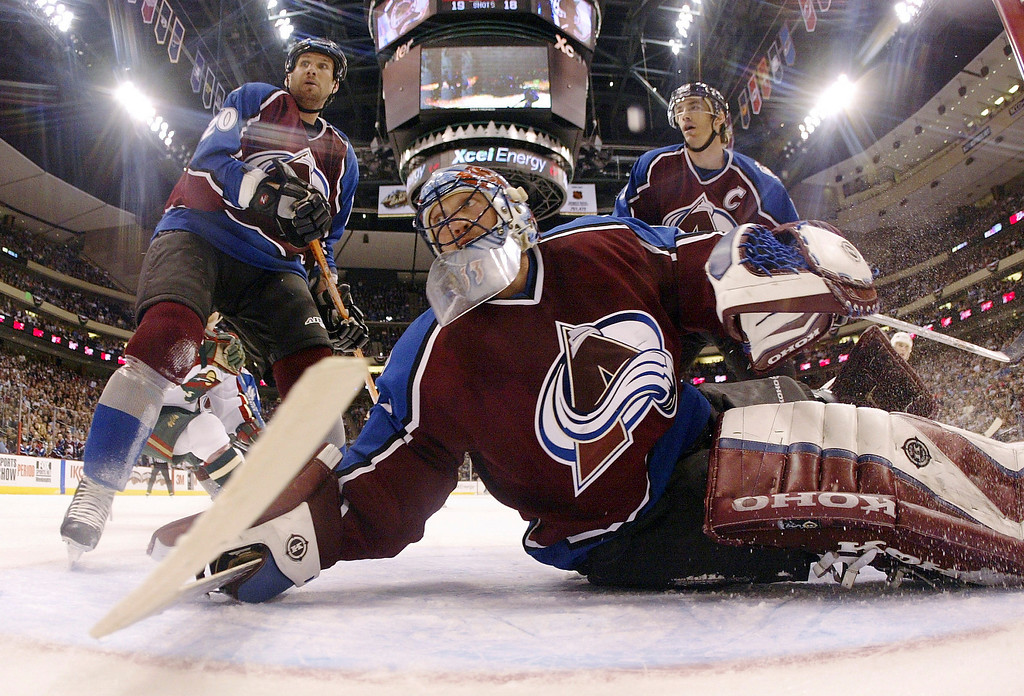 . Goalie Patrick Roy of the Colorado Avalanche follows the puck as it flies behind the goal against the Minnesota Wild in the third period during game four of the first round of the NHL playoffs on April 16, 2003 at the Xcel Center in St. Paul, Minnesota.  The Avs won 3-1.  (Photo by Brian Bahr/Getty Images/NHLI)