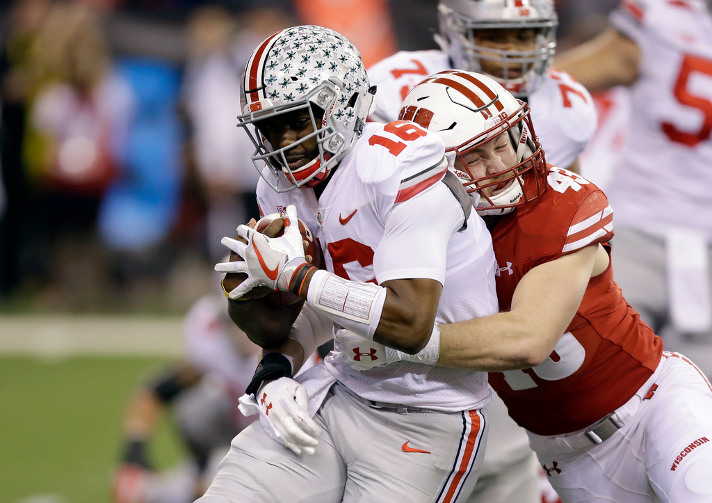 . Ohio State quarterback J.T. Barrett, left, is tackled by Wisconsin\'s Ryan Connelly during the first half the Big Ten championship NCAA college football game, Saturday, Dec. 2, 2017, in Indianapolis. (AP Photo/AJ Mast)