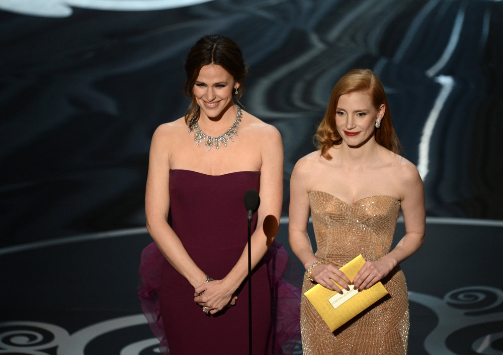 Description of . Actresses Jennifer Garner and Jessica Chastain present onstage during the Oscars held at the Dolby Theatre on February 24, 2013 in Hollywood, California.  (Photo by Kevin Winter/Getty Images)