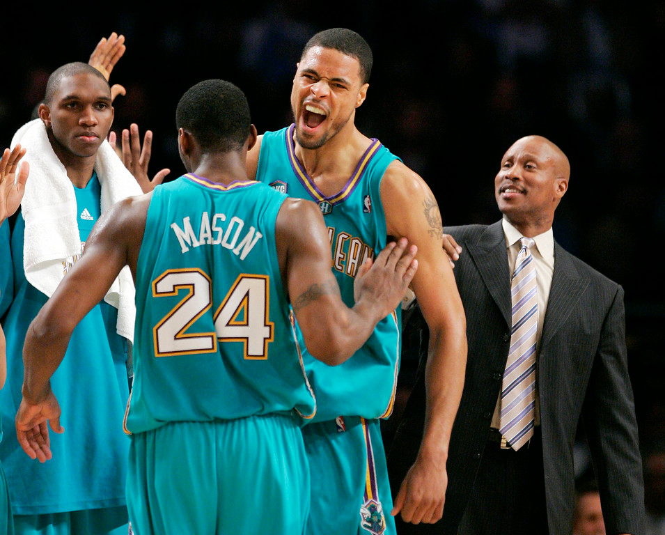 . New Orleans Hornets\' Desmond Mason is congratulated by teammate Tyson Chandler after he dunked the ball in the closing seconds as head coach Byron Scott, right, looks on in their NBA basketball game against the Los Angeles Lakers, Wednesday, Dec. 6, 2006, in Los Angeles. (AP Photo/Mark J. Terrill)