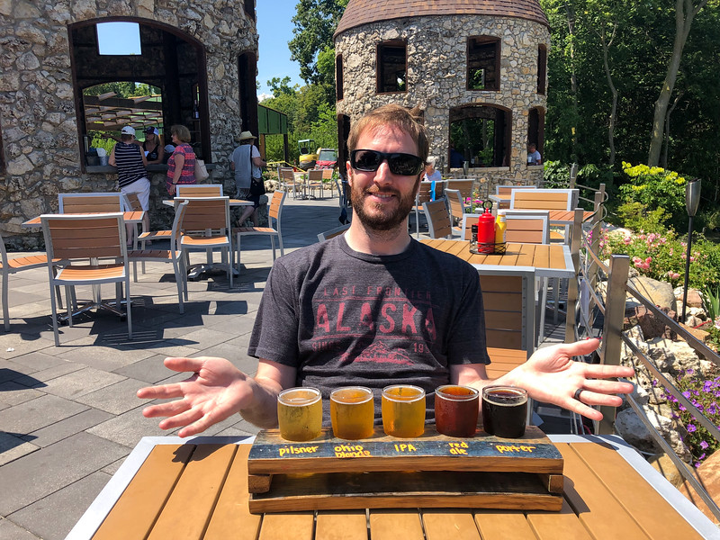 Elliot with a beer flight at Twin Oast Brewing