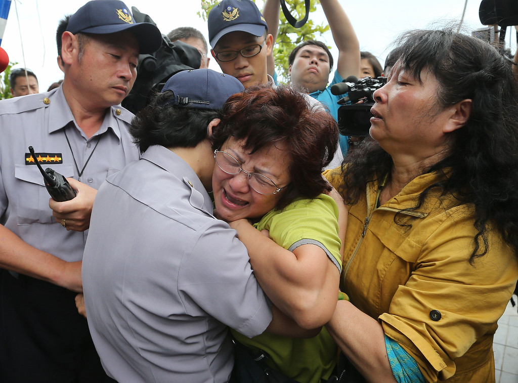 . A relative of a passenger onboard the TransAsia Airways Flight GE222 that crashed on the Taiwanese island of Penghu, cries at a funeral parlor in Penghu, Taiwan, Thursday, July 24, 2014. (AP Photo)