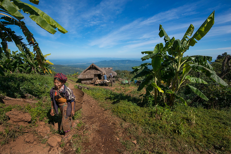 woman leaving her home to go and work in the fields,   Chin State, Myanmar,2017.
