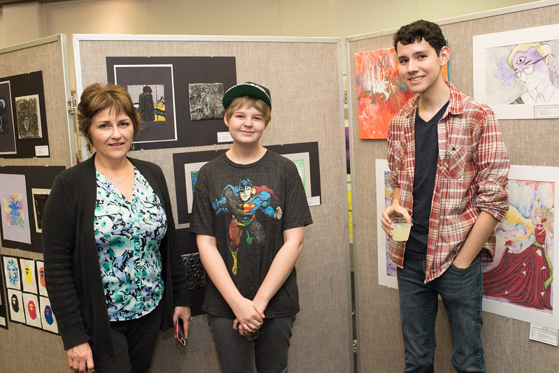 Debbie Zafereo (left), Madeline Plumb, and Jacob Benavides during the CCISD Art Gallery in the Mary and Jeff Bell Library.