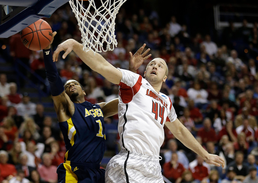 . North Carolina A&T forward Adrian Powell (1) has his shot blocked by Louisville forward Stephan Van Treese (44) during the first half of a second-round game in the NCAA college basketball tournament, Thursday, March 21, 2013, in Lexington, Ky. (AP Photo/John Bazemore)
