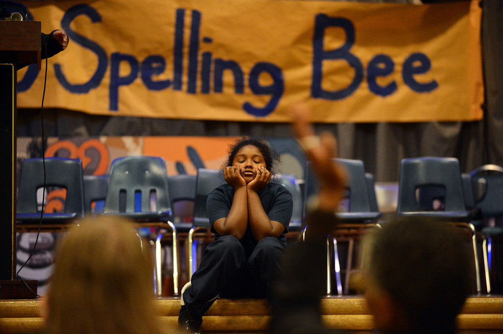""". Sankofa Academy fifth-grader Aisha Ramsey can only listen as sixth-grader Adam Ansari correctly spells \""""defunct\"""" to win the school\'s second annual spelling bee in Oakland, Calif. on Wednesday, Jan. 23, 2013. Aisha finished second and will represent the elementary grades at the district level spelling bee in February. (Kristopher Skinner/Staff)"""