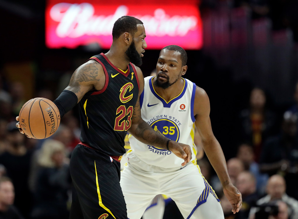 . Cleveland Cavaliers\' LeBron James is defended by Golden State Warriors\' Kevin Durant in the first half of Game 3 of basketball\'s NBA Finals, Wednesday, June 6, 2018, in Cleveland. (AP Photo/Tony Dejak)