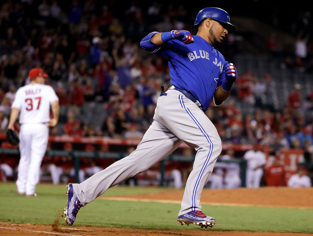 . Toronto Blue Jays\' Edwin Encarnacion rounds the bases after a two-run home run against the Los Angeles Angels during the ninth inning of a baseball game in Anaheim, Calif., Friday, Sept. 16, 2016. (AP Photo/Chris Carlson)