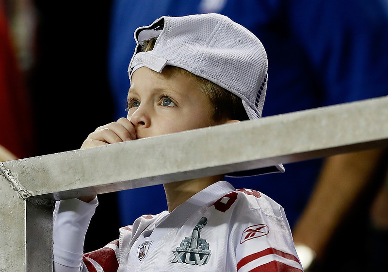 . A New York Giants fan reacts as he watches the final minutes of the Giants 34-0 loss to the Atlanta Falcons at Georgia Dome on December 16, 2012 in Atlanta, Georgia.  (Photo by Kevin C. Cox/Getty Images)