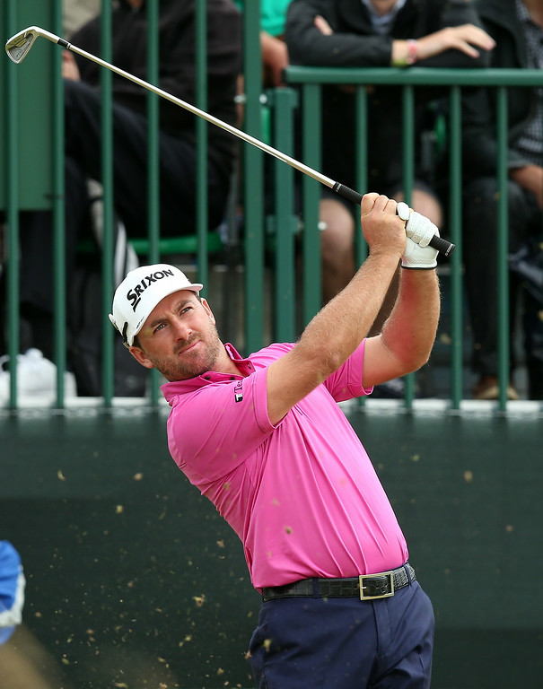 . Northern Ireland\'s Graeme McDowell watches his shot from the 13th tee during his fourth round 67, on the final day of the 2014 British Open Golf Championship at Royal Liverpool Golf Course in Hoylake, north west England on July 20, 2014.  ANDREW YATES/AFP/Getty Images