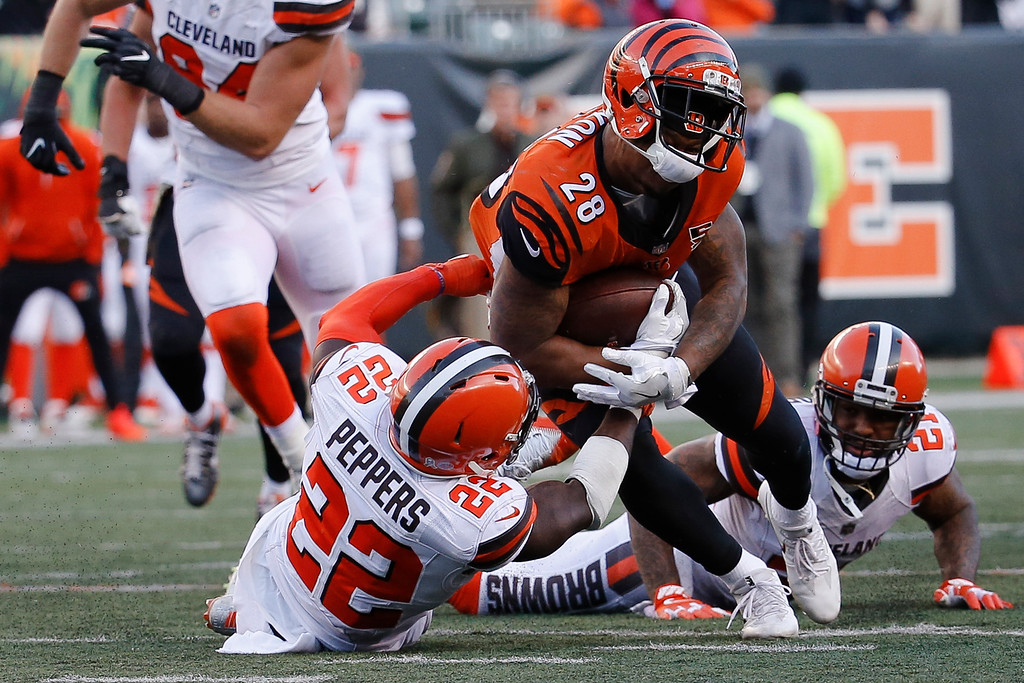. Cincinnati Bengals running back Joe Mixon (28) is tackled by Cleveland Browns free safety Jabrill Peppers (22) in the second half of an NFL football game, Sunday, Nov. 26, 2017, in Cincinnati. (AP Photo/Frank Victores)