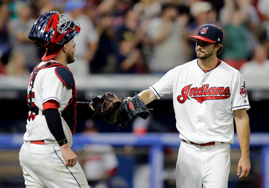 . Cleveland Indians relief pitcher Ryan Merritt, right, is congratulated by catcher Roberto Perez after the Indians defeated the Toronto Blue Jays 13-3 in a baseball game, Friday, July 21, 2017, in Cleveland. (AP Photo/Tony Dejak)