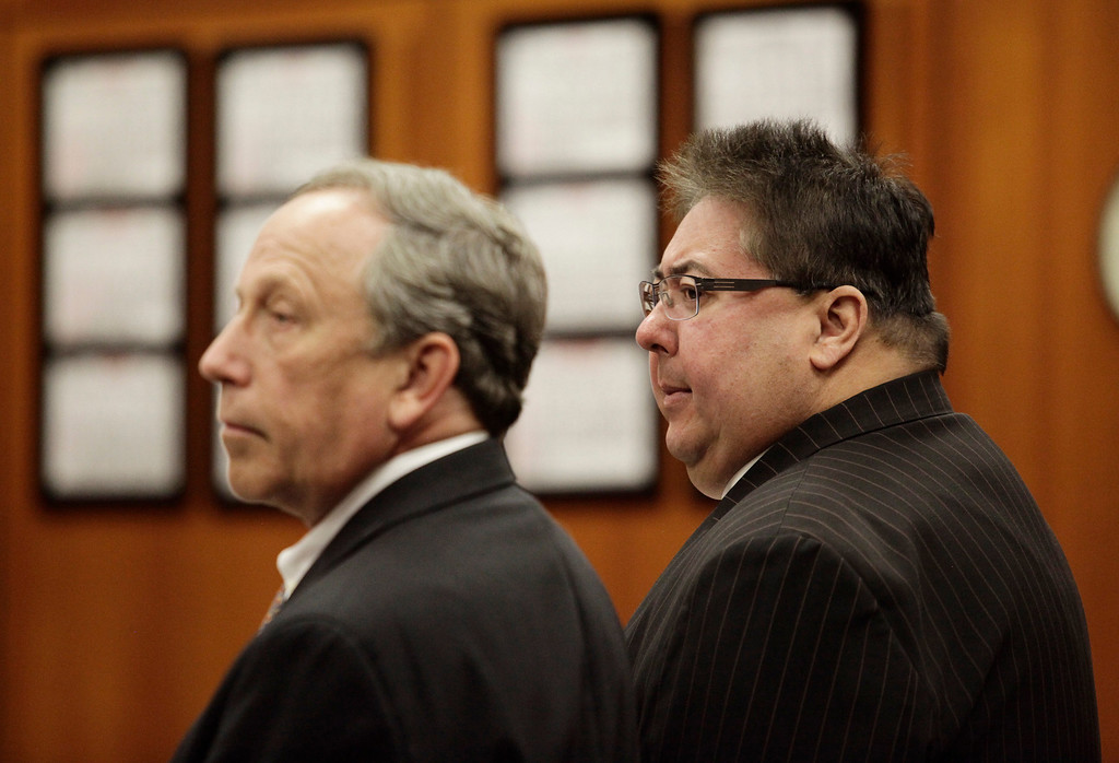 . George Shirakawa Jr., right, and his attorney, John Williams, left, listen to the court proceedings in Santa Clara County Superior Court in San Jose, Calif. on Monday, March 18, 2013. Shirakawa pleaded guilty to five felonies, including four counts of perjury and one count of misappropriation of public funds, as well as seven misdemeanors for failing to file accurate campaign reports.  (Gary Reyes/ Staff)