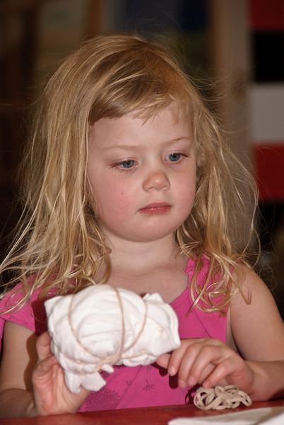 Ella listening to the tie dye instructions.