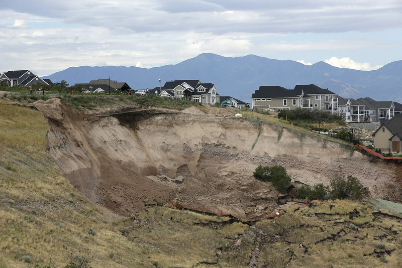 . A hillside is shown following a landslide in a hillside community of North Salt Lake, Utah, Tuesday, Aug. 5, 2014. North Salt Lake officials say more than 20 homes have been evacuated following an early morning landslide that destroyed one hillside home. (AP Photo/Rick Bowmer)