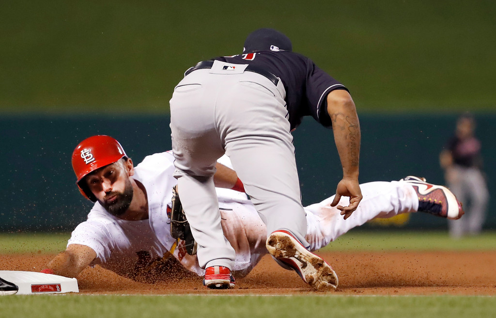 . St. Louis Cardinals\' Matt Carpenter is tagged out by Cleveland Indians third baseman Jose Ramirez, right, while trying to reach third base during the first inning of a baseball game Monday, June 25, 2018, in St. Louis. (AP Photo/Jeff Roberson)