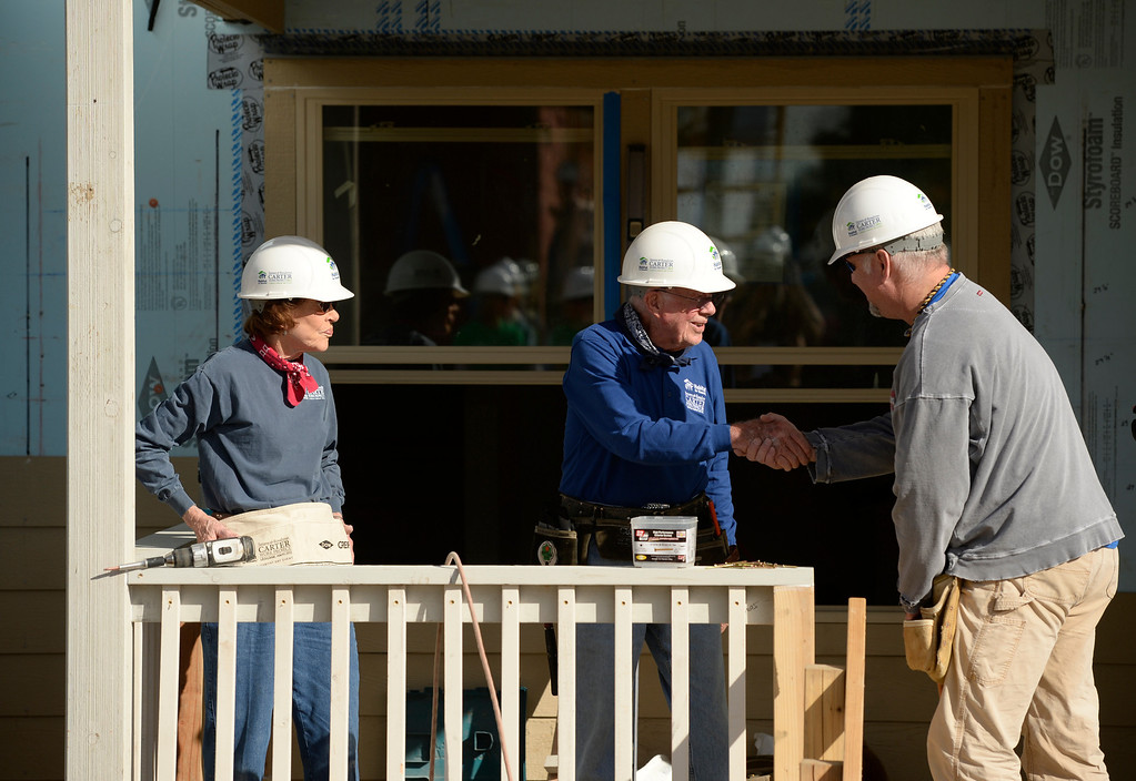 . DENVER, CO - OCTOBER 09: Former president Jimmy Carter and his wife, Rosalynn, to his left, work with country singer Garth Brooks on building a home during Habitat for Humanity\'s Carter Work Project event in the Globeville Neighborhood in Denver, October 09, 2013. Since 1984 the former president and his wife have dedicated a week of their time to help build Habitat homes. (Photo By RJ Sangosti/The Denver Post)