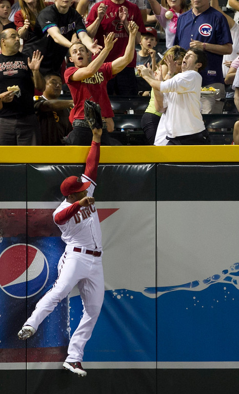 . Diamondbacks  outfielder Alfredo Marte can\'t make a catch on a solo home run from the Rockies\' Wilin Rosario in the sixth inning of a baseball game against the Colorado Rockies on Friday, April 26, 2013 in Phoenix. (AP Photo/The Arizona Republic, David Wallace)  MARICOPA COUNTY OUT; MAGS OUT; NO SALES