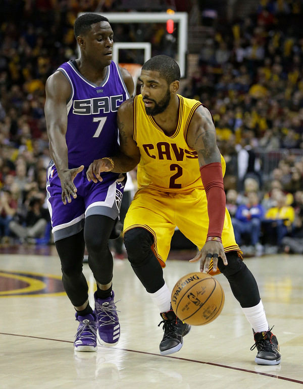 . Cleveland Cavaliers\' Kyrie Irving (2) drives against Sacramento Kings\' Darren Collison (7) in the second half of an NBA basketball game, Wednesday, Jan. 25, 2017, in Cleveland. (AP Photo/Tony Dejak)