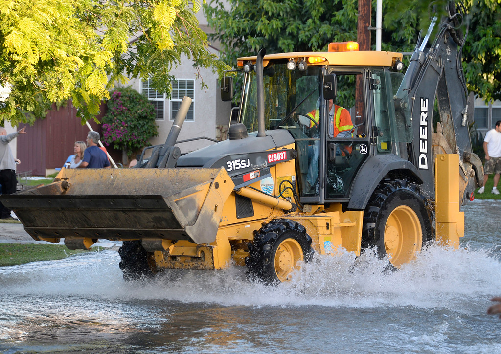 . June 17,2014. Burbank. CA. City crews make there way through the water to fix a 30 inch water main broke at the Burbank Fire training center Tuesday. The water created a river in the streets that were near by the brake but did not flood any homes near by. Burbank water and power crews are on scene working to shut off the water.  Photo by Gene Blevins/LA DailyNews