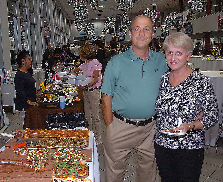 . Bob and Mary Cermignano enjoys the variety of fine foods during \'A Taste of Ardmore\' held at Ardmore Toyota recently.