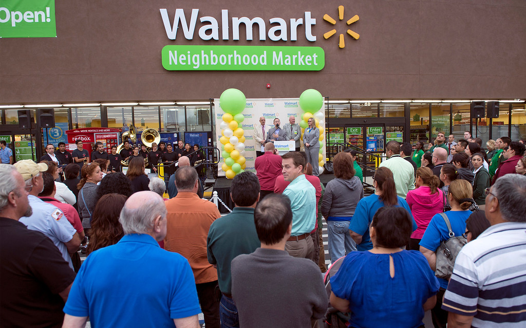 . Walmart staff, La Puente officials and members of the public attend the grand opening of Walmart Neighborhood Market at 1425 N. Hacienda Boulevard in La Puente, Calif. October 2, 2013.  (Staff photo by Leo Jarzomb/SGV Tribune)