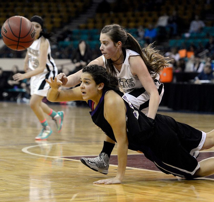 . DENVER, CO. - MARCH 9TH: Sami Rudd, left, Mesa Ridge High School, and Kendra Jeslik, Pueblo South, fight for control of the ball in the second half of the 4A �Great Eight� game at the Denver Coliseum, Saturday morning, March 9th, 2013. Pueblo South won 54-33 to advance to the Final Four at the CU Events Center, March 14th, 2013. (Photo By Andy Cross The Denver Post)