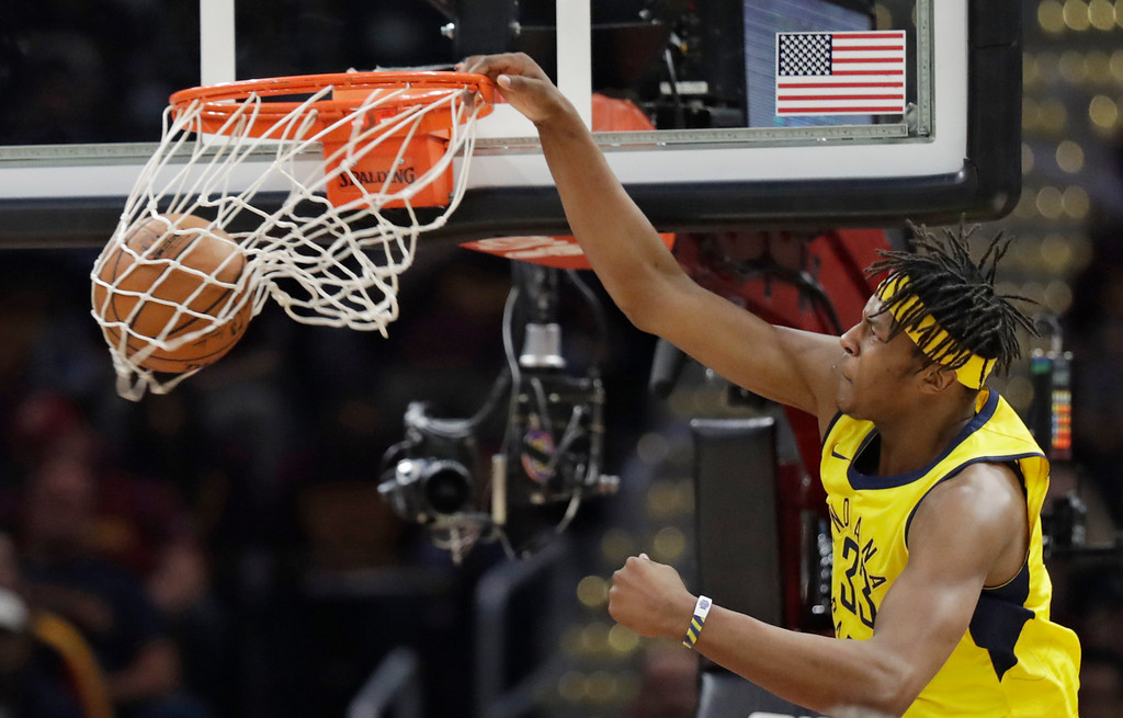 . Indiana Pacers\' Myles Turner dunks the ball against the Cleveland Cavaliers in the first half of Game 5 of an NBA basketball first-round playoff series, Wednesday, April 25, 2018, in Cleveland. (AP Photo/Tony Dejak)