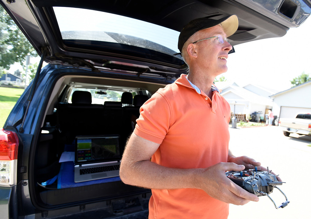 . LONGMONT, CO - AUGUST 9:  Tim Haynie, of Arbor Drone, watches the flight of the drone.  Arbor Drone LLC and Spectrabotics LLC,  collected data using drone flights over northwest Longmont on August 9, 2018, to study and monitor trees affected by Emerald Ash Borer (EAB).  Longmont will be one of the last EAB detection flights for 2018 for the team. Drone flights in urban areas to study tree pests have never been conducted at this scale. (Photo by Cliff Grassmick/Staff Photographer)