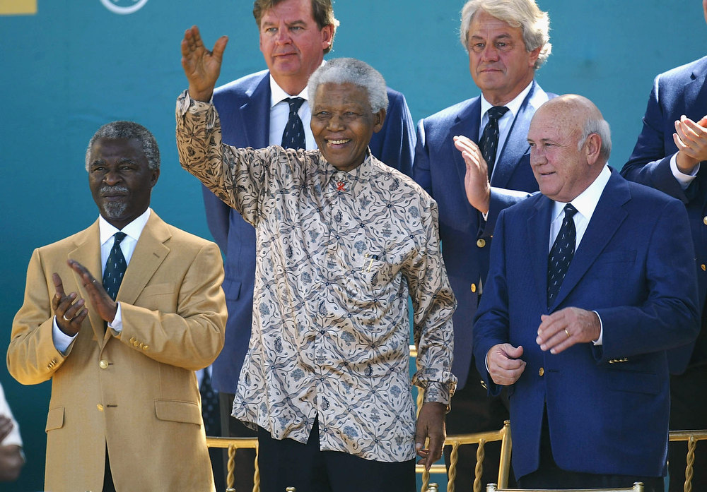 Description of . Thabo Mbeki, President of South Africa Nelson Mandela and F.W Deklerk attend the opening ceremony for The Presidents Cup between USA and The Internatioanl team on November 20, 2003 at The Links Fancourt Golf Course, George, South Africa.  (Photo by Stuart Franklin/Getty Images)