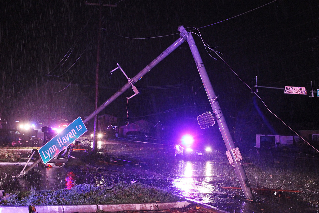 . The street light at Howdershell Road and Lynn Haven Lane lies damaged following high winds from a strong spring storm in Hazelwood late Wednesday evening, April 10, 2013.   (AP Photo/Erik M. Lunsford, Post-Dispatch)