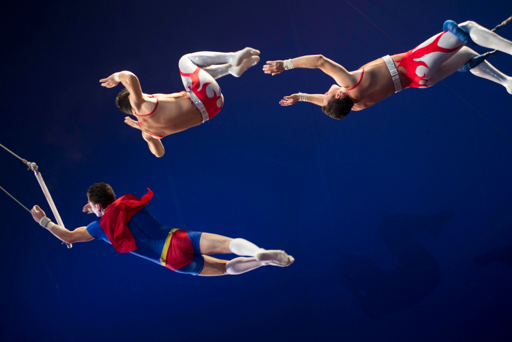 Description of . In this June 22, 2014 photo, trapeze artists Bebeto Fuentes, left, and his brothers, Alex, center, and Juventino, right, perform at the Fuentes Gasca Brothers Circus in Mexico City. For five generations, the Fuentes family has been running the Fuentes Gasca Brothers Circus in Mexico City, but a new law has them worried about its future. Last week Mexico City's legislative assembly banned the use of animals in circuses, responding to months of pressure from animal activists. (AP Photo/Sean Havey)