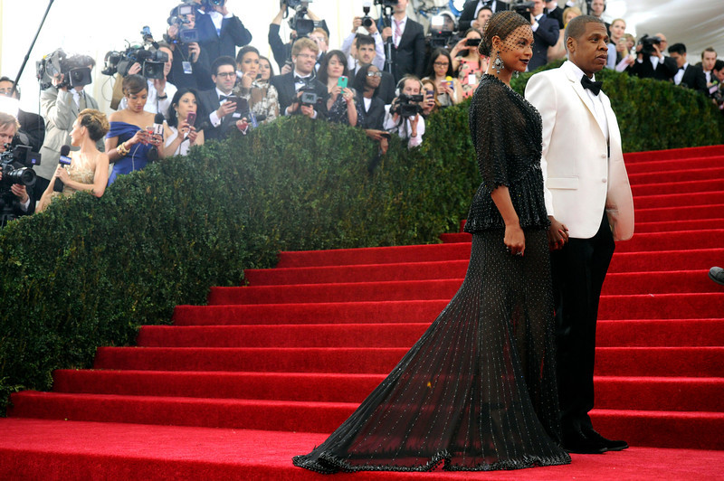 """. Beyonce and Jay-Z attend The Metropolitan Museum of Art\'s Costume Institute benefit gala celebrating \""""Charles James: Beyond Fashion\"""" on Monday, May 5, 2014, in New York. (Photo by Charles Sykes/Invision/AP)"""
