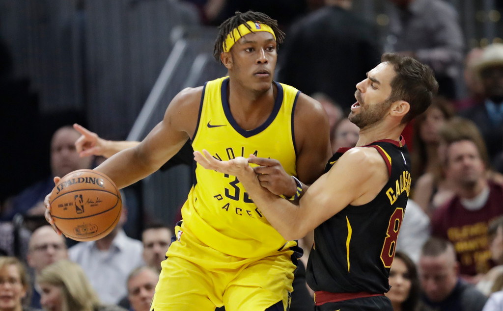 . Indiana Pacers\' Myles Turner, left, drives past Cleveland Cavaliers\' Jose Calderon, from Spain, in the first half of Game 5 of an NBA basketball first-round playoff series, Wednesday, April 25, 2018, in Cleveland. The Cavaliers won 98-95. (AP Photo/Tony Dejak)