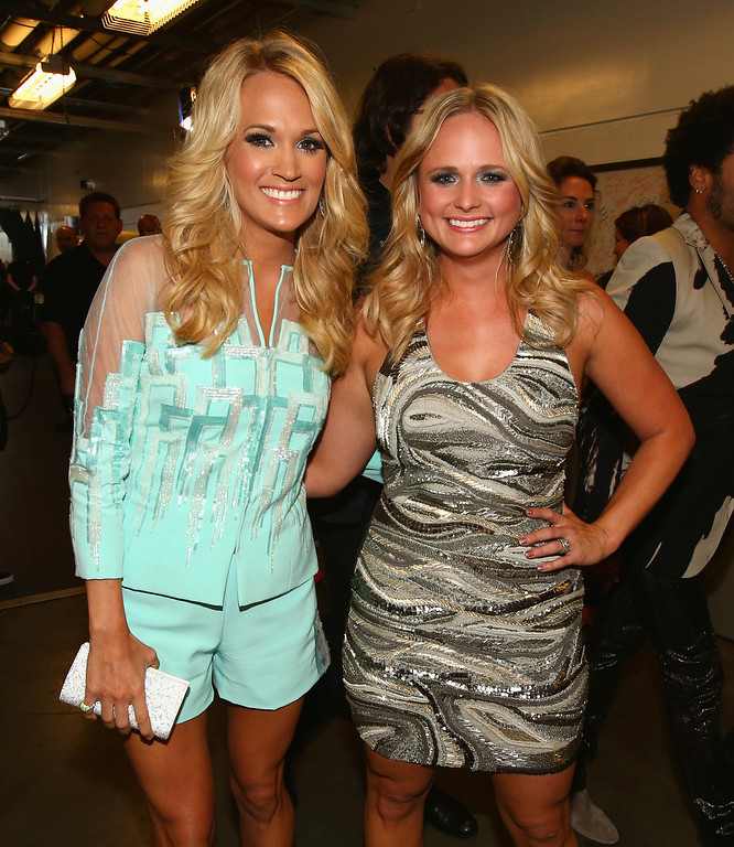 . NASHVILLE, TN - JUNE 05:  Carrie Underwood (L) and Miranda Lambert attend the 2013 CMT Music awards at the Bridgestone Arena on June 5, 2013 in Nashville, Tennessee.  (Photo by Christopher Polk/Getty Images)