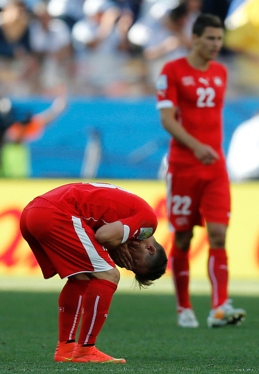 . Switzerland\'s Xherdan Shaqiri, left, reacts after Argentina\'s Angel di Maria scored the opening goal tduring the World Cup round of 16 soccer match between Argentina and Switzerland at the Itaquerao Stadium in Sao Paulo, Brazil, Tuesday, July 1, 2014. (AP Photo/Frank Augstein)